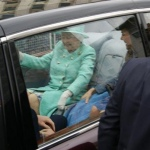 laughing queen in state car